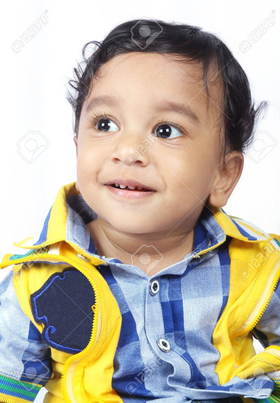 beautiful indian cute baby looking up stock photo, picture and