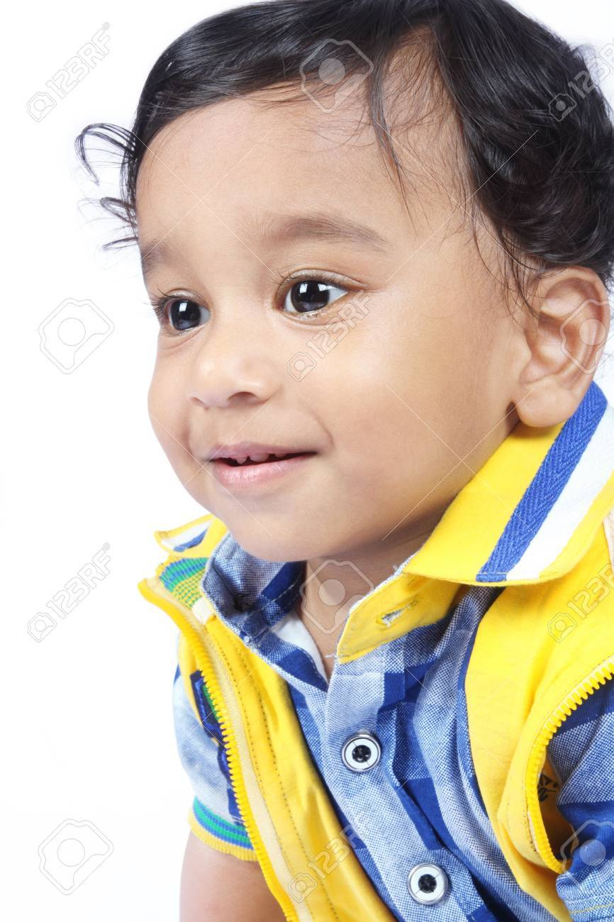 indian cute baby looking somewhere stock photo, picture and royalty