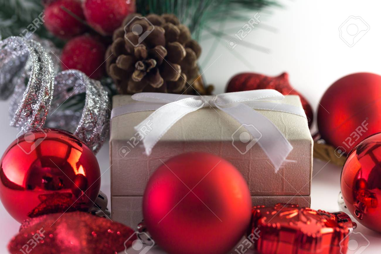stock photo white gift box with red and silver christmas decorations and pine cone