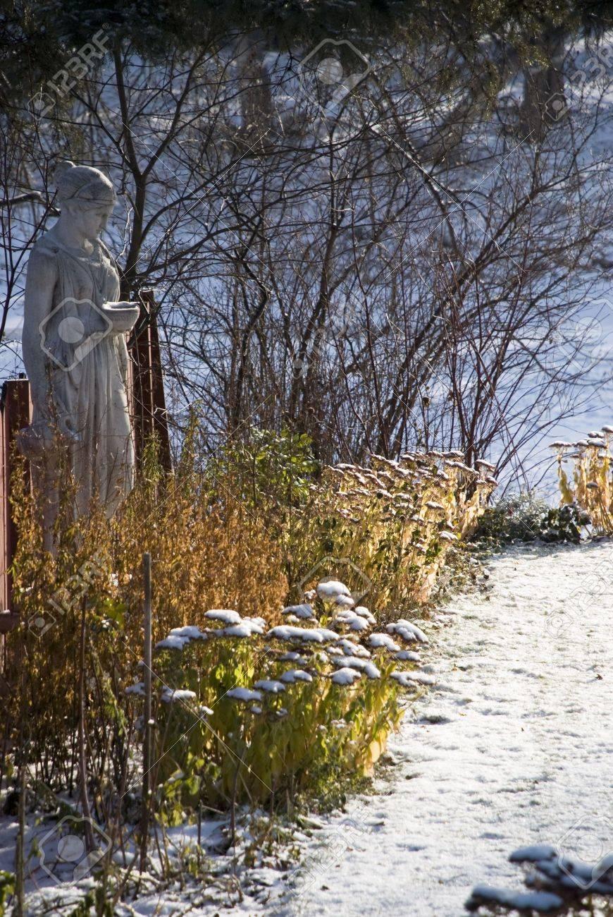 Garden Statute in First snow amongst fall vegetation Stock Photo - 2138207