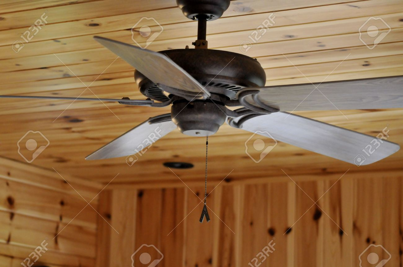 Ceiling fan in knotty pine room stock photo picture and royalty ceiling fan in knotty pine room stock photo 4845330 aloadofball Gallery