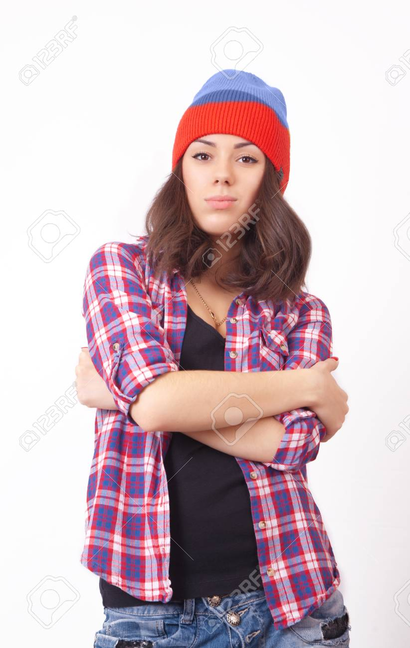 372eee57590 Cute hipster teenage girl with beanie hat posing looking at camera Stock  Photo - 34673223