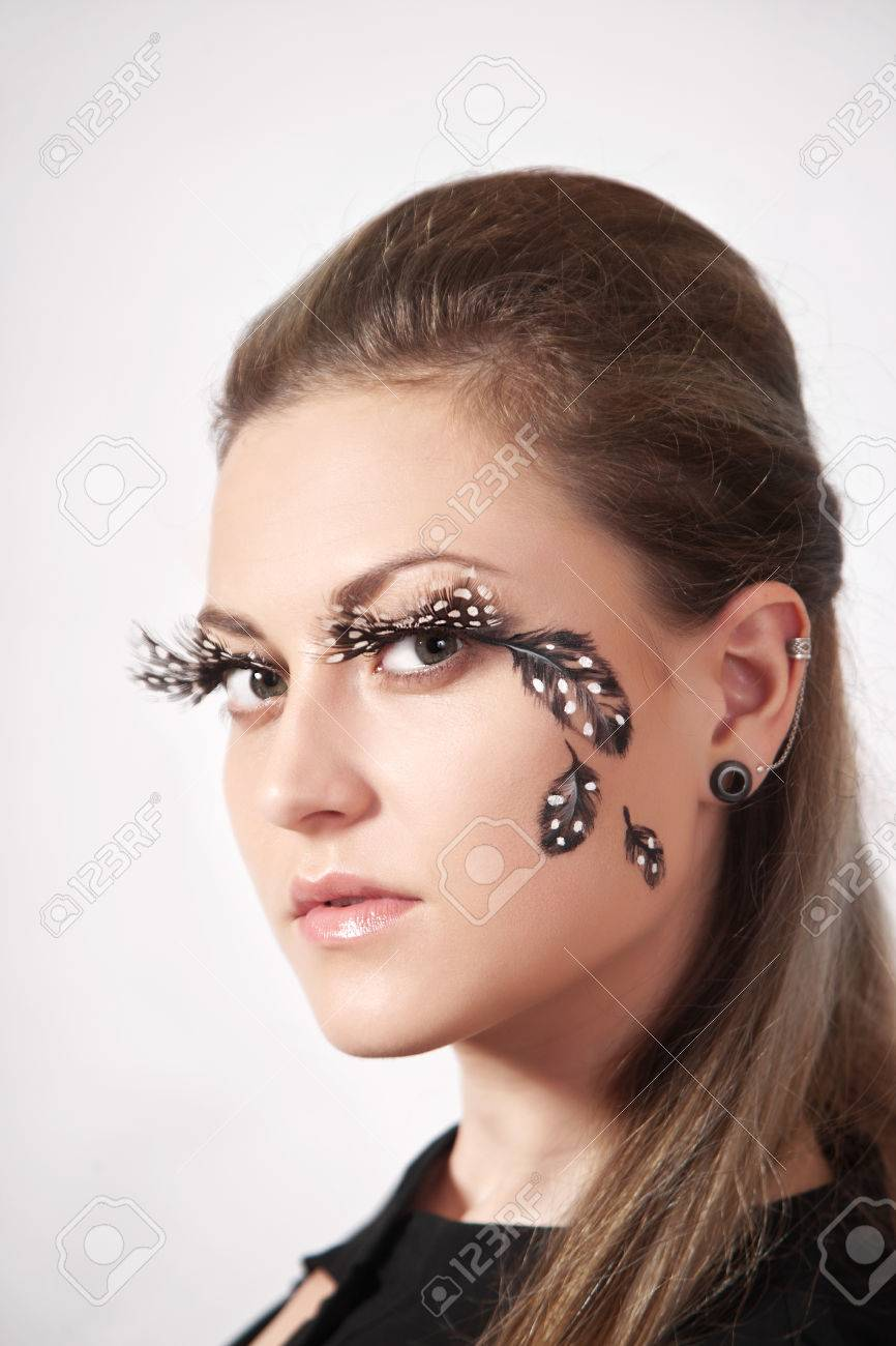 0752a4d6f7b Beautiful woman with big eyelashes and face-art, studio shooting Stock  Photo - 47940230