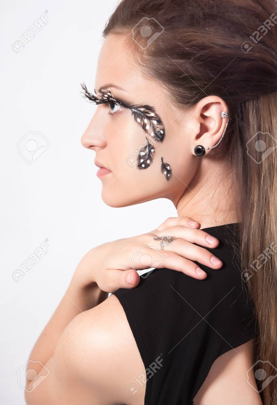 5ba96f74c41 Beautiful woman with big eyelashes and face-art, studio shooting Stock  Photo - 47993025