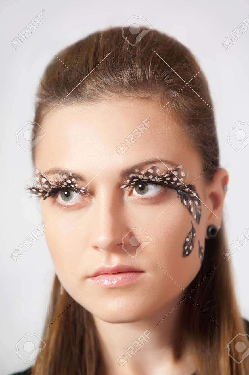37f4b5a915b Beautiful woman with big eyelashes and face-art, studio shooting Stock  Photo - 49136620
