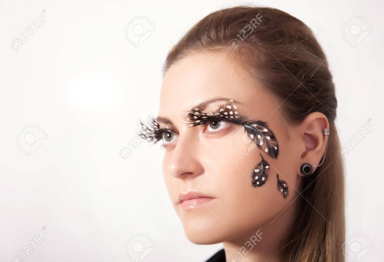 dcf35949532 Beautiful woman with big eyelashes and face-art, studio shooting Stock  Photo - 49136622
