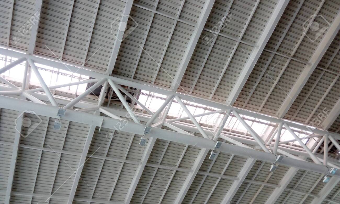 Heavy weight structural steel roof or double height ceiling of an Airport Building interior at chennai international airport - 136008808
