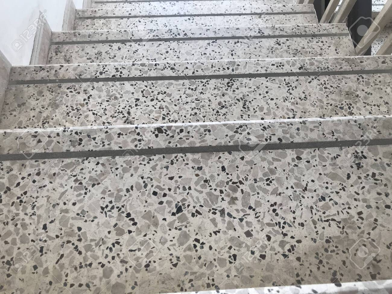 Non slip grooves made over the Treads of Staircase finished by Granite stone flooring and for steps of an high rise building fire emergency escape stairs - 144621452