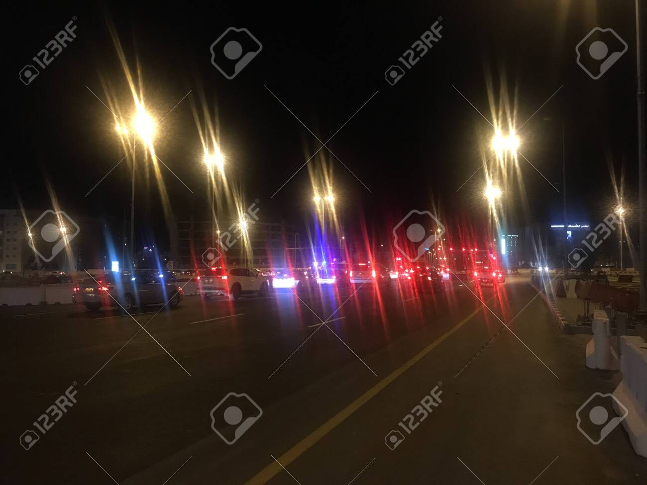At weekend mode going to celebrate weekend in car in urban city road with glittering street lights and downtown is awesome to get themselves rock the motion of speed cars - 145574500