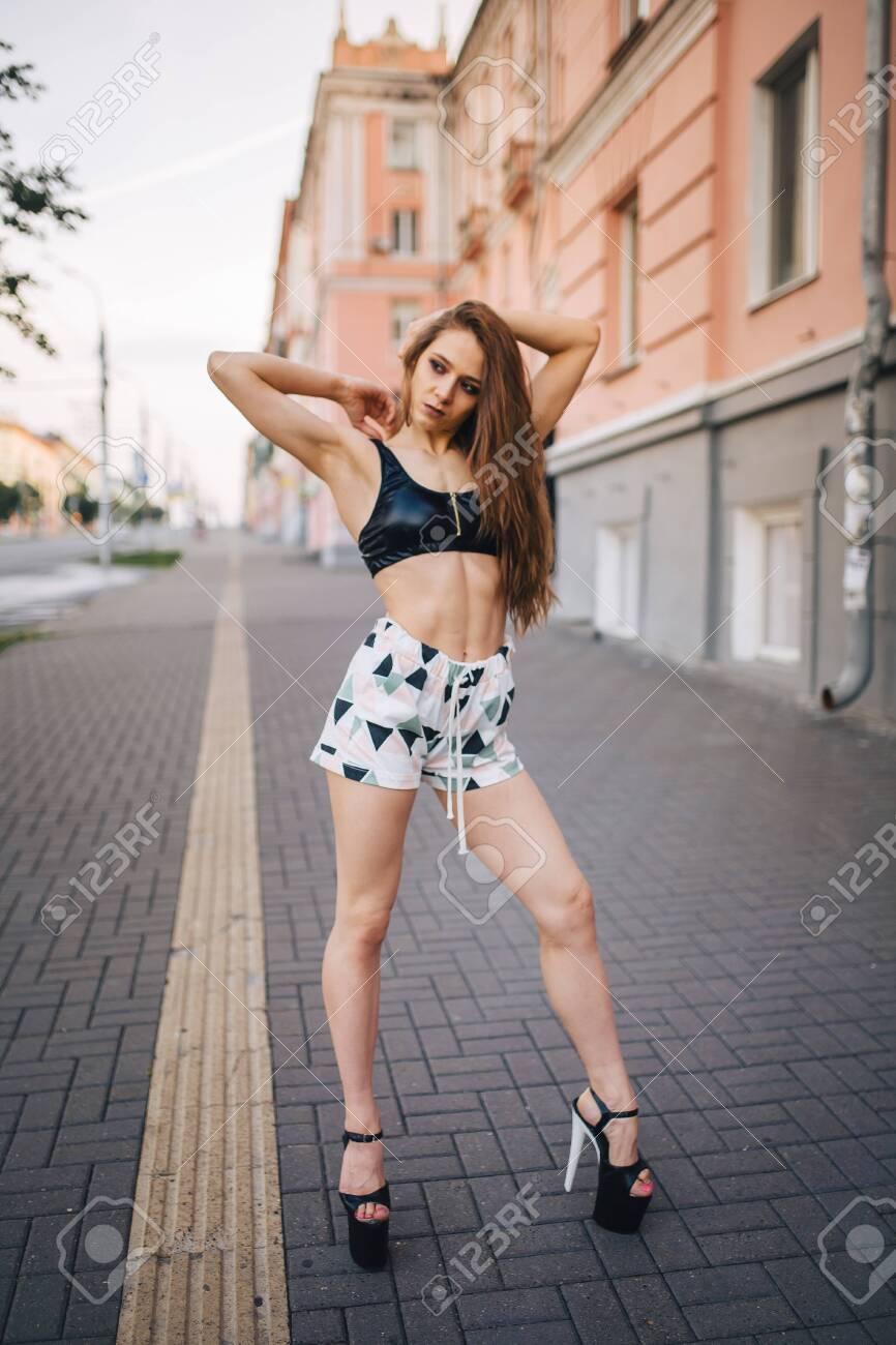 High Heels Posing Among The Streets