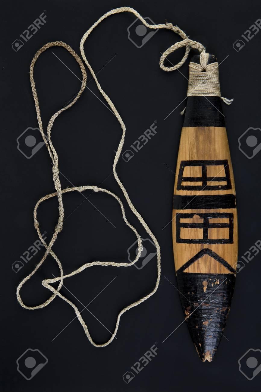 Replica of ancient artifact rainmaker bullroarer Stock Photo - 93813033