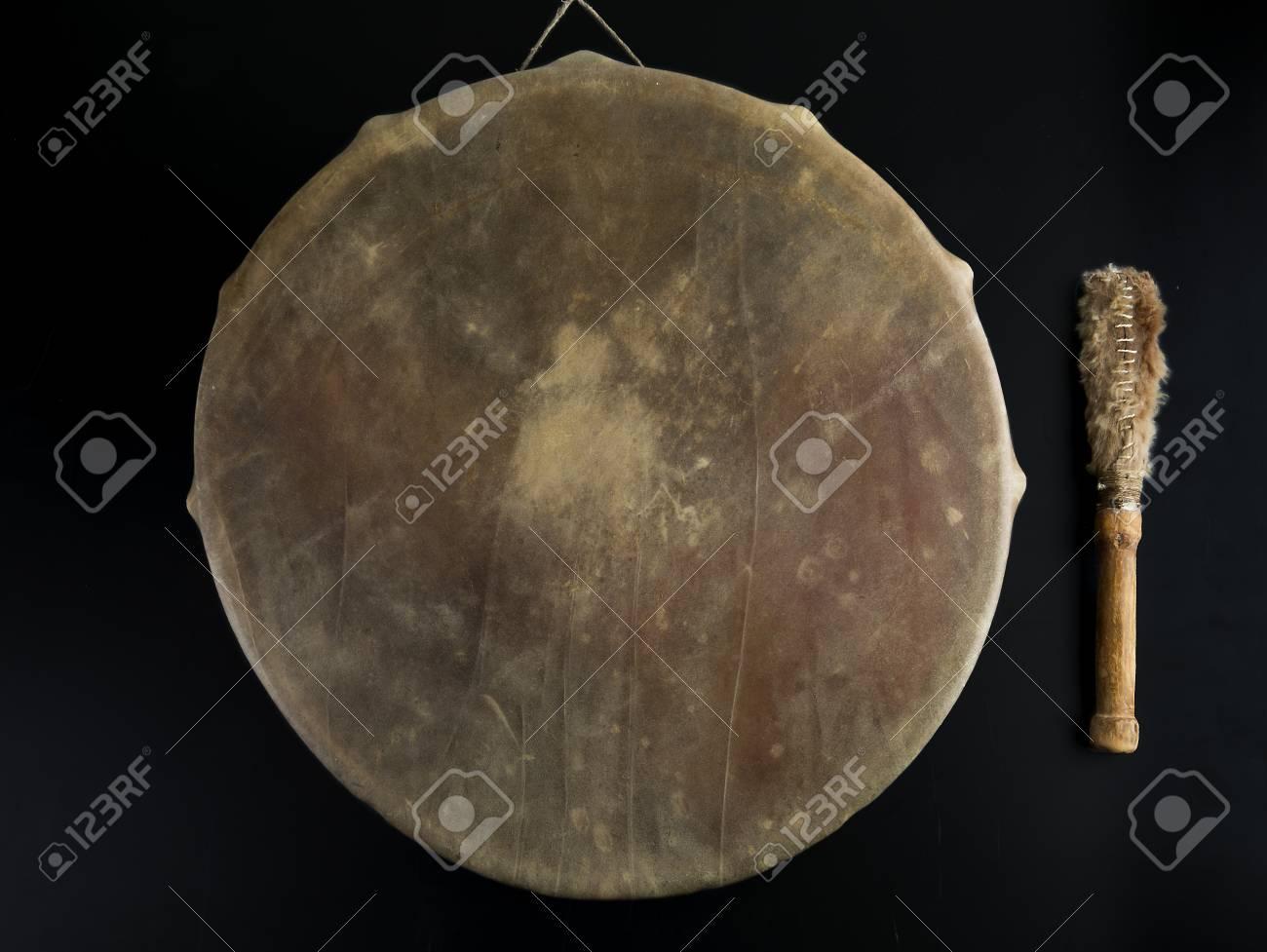 Ancient indian tambourine drum drumstick replica Stock Photo - 93857799