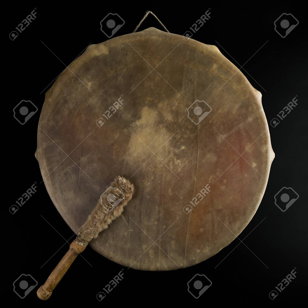 Ancient indian tambourine drum drumstick replica Stock Photo - 93865436