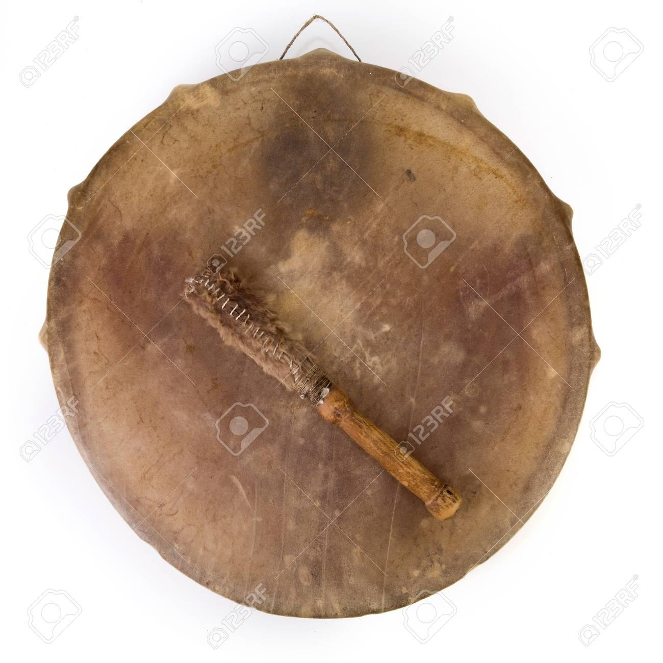 Ancient indian tambourine drum drumstick replica Stock Photo - 94345995