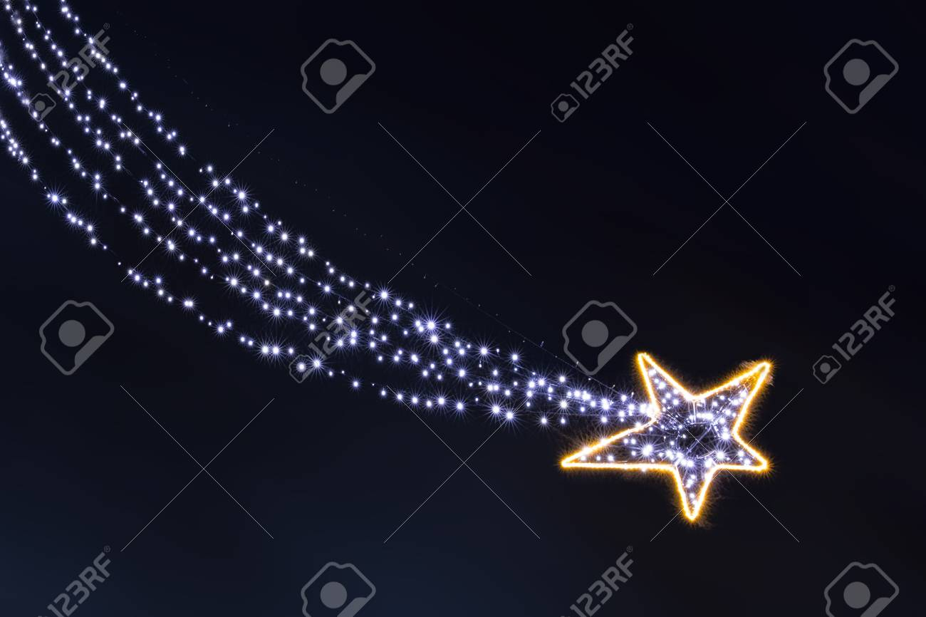 Lonely glowing in dhe dark garland light bulbs falling star isolated Stock Photo - 94468972