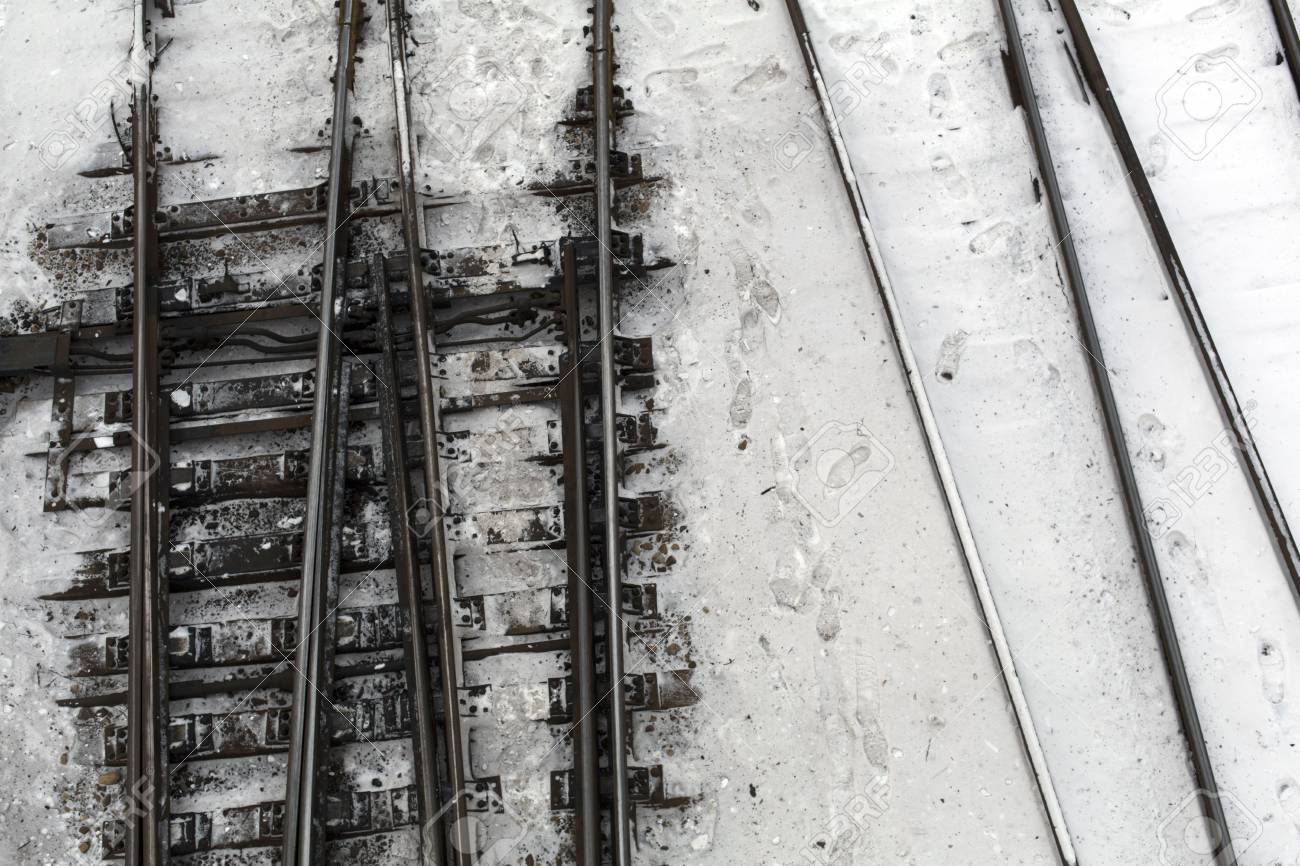 Winter top view on railway tracks and switch in snow background Stock Photo - 94487223