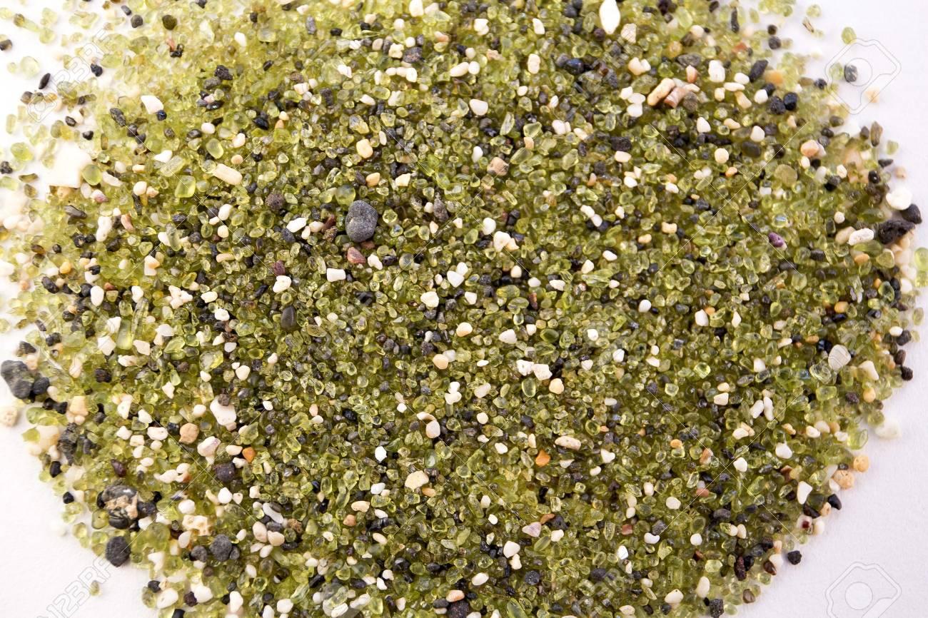 The greenest Papakolea Beach sand closeup on white Stock Photo - 94838461