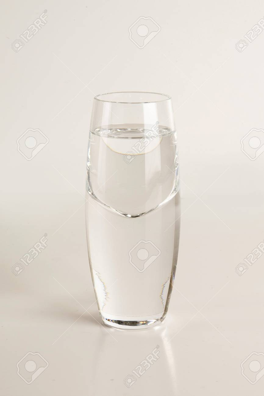 Glass of vodka on light gray background Stock Photo - 94815351