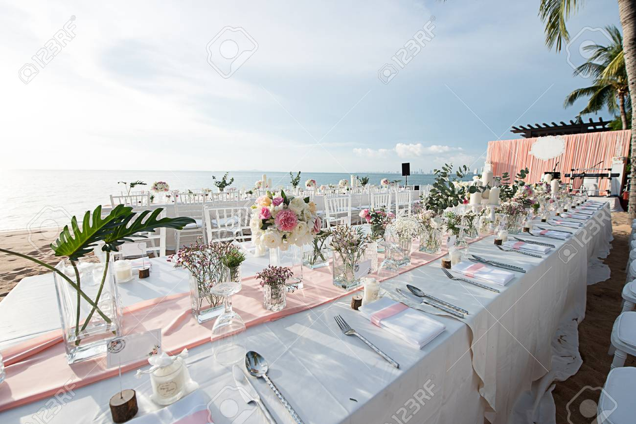 Wedding Table Setup On The Beach With Sunset Time Stock Photo ...