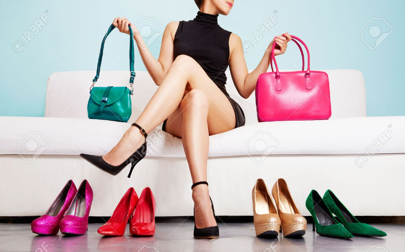 Colorful shoes and bags with woman sitting on the sofa. - 52756088