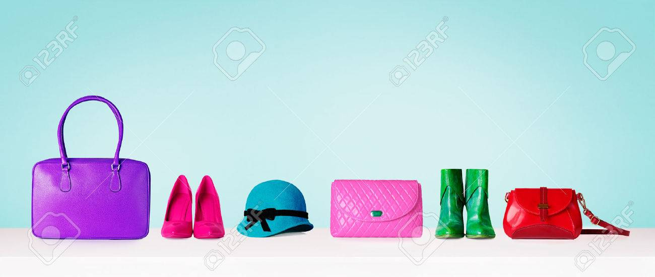 Colorful hand bags, shoes, and hat isolated on light blue background. Woman fashion accessories item. Shopping image. - 61840872