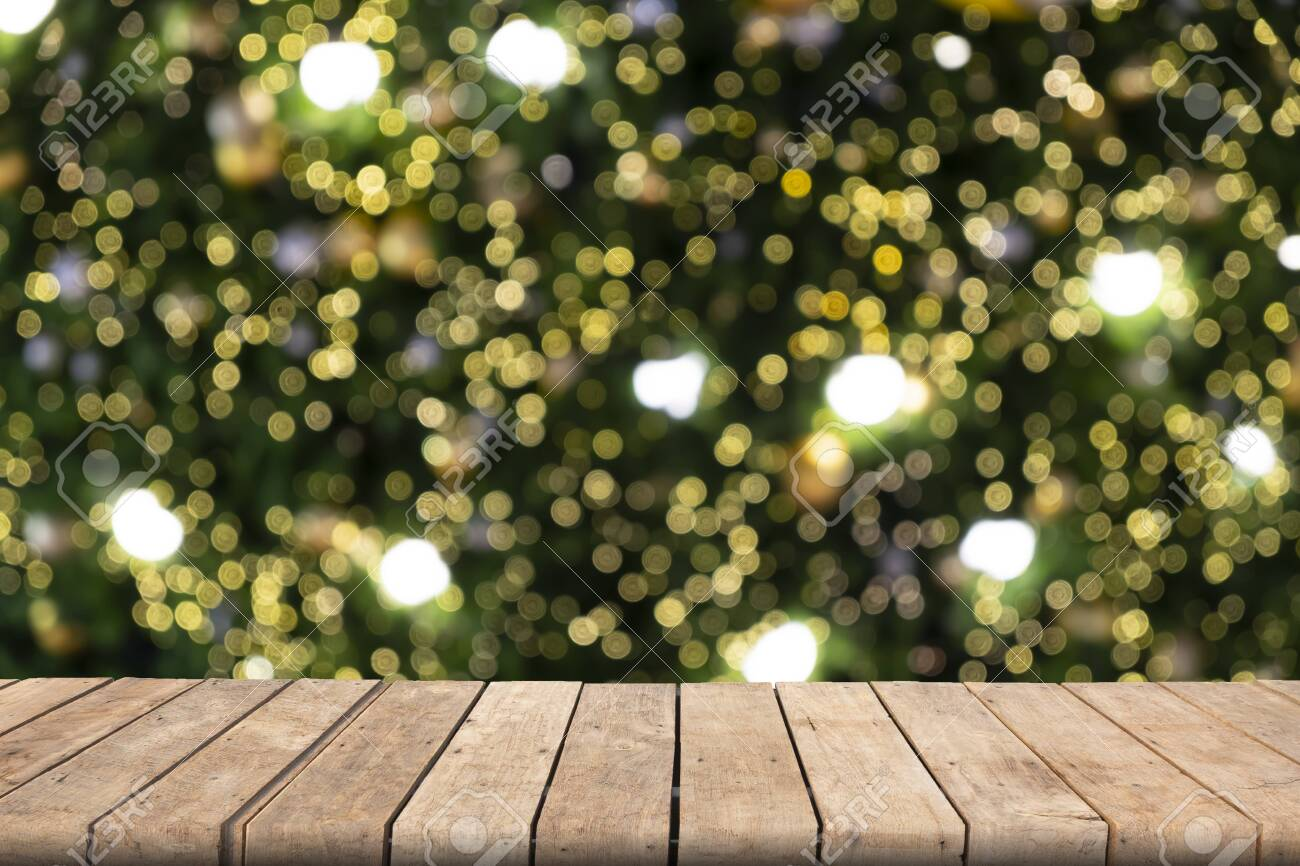 Wooden table on front blurred colorful bokeh background, abstract, used for presentation and template, banner website - 122663042