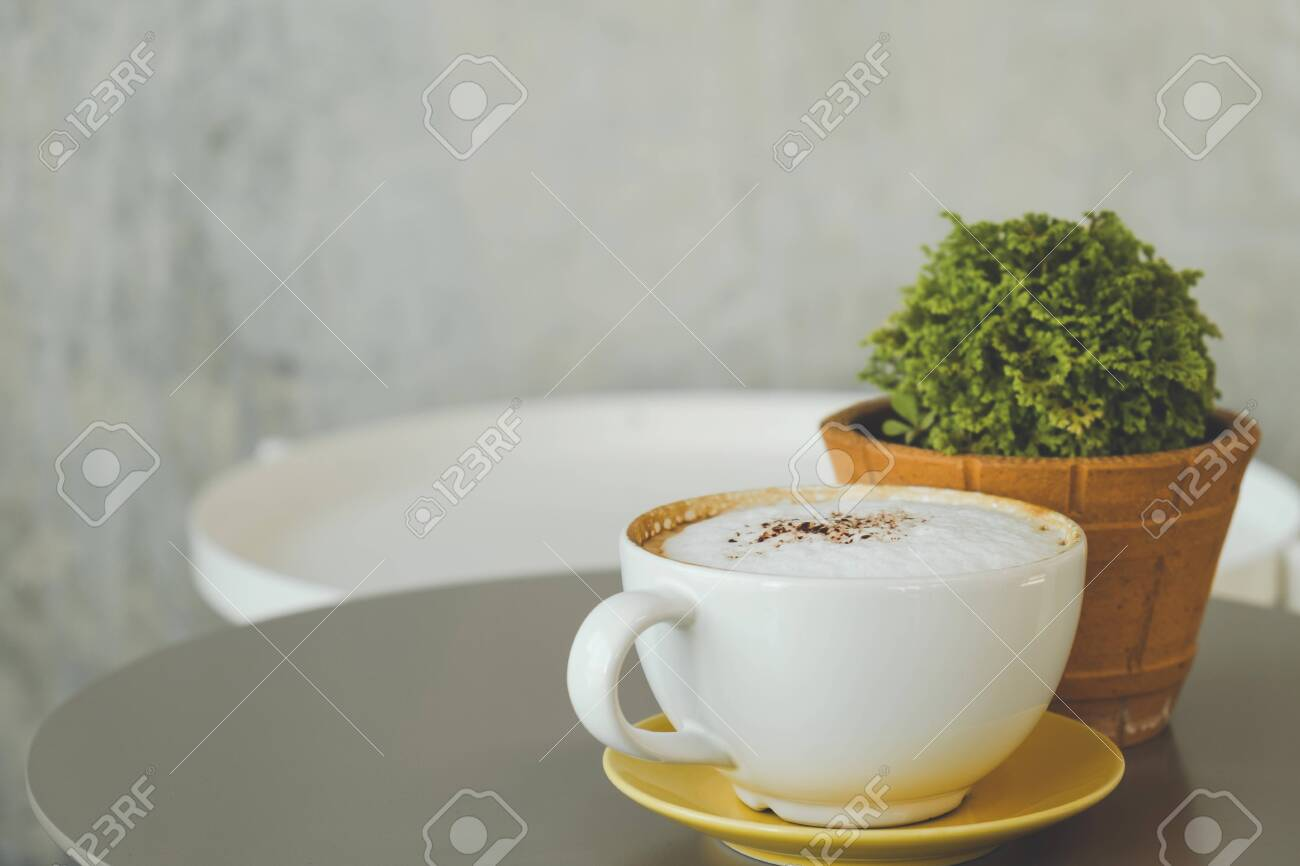 Coffee on the desk, copy space background - 122663071
