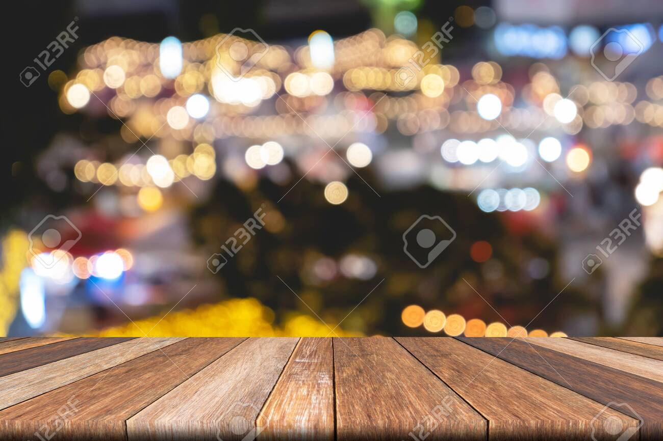 Empty wooden table of brown on front blurred colorful background, for presentation and advertising product and template, website banner - 122663082