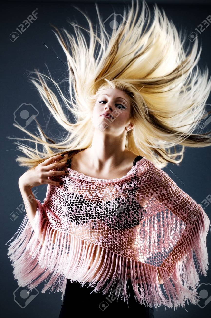 Beautiful blond female with flying hair and transparent top Stock Photo - 3653844