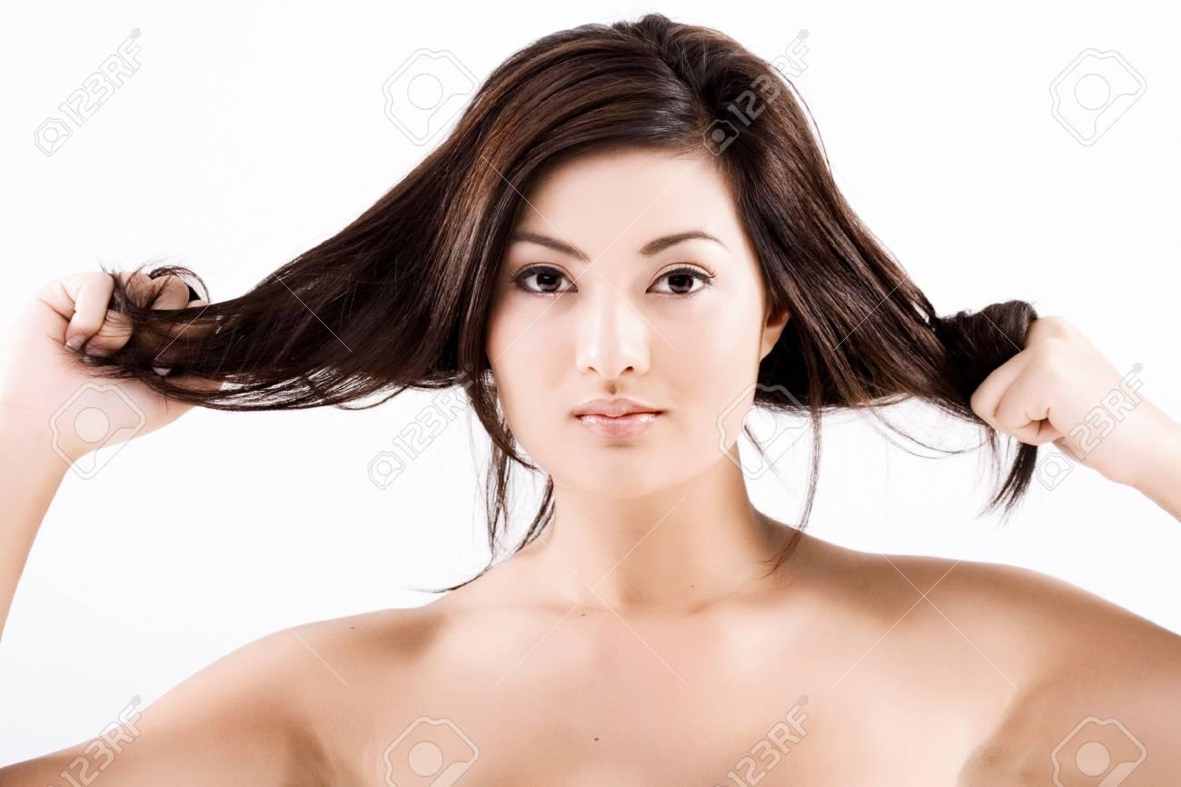 Beautiful natural asian woman pulling dark hair Stock Photo - 3968289