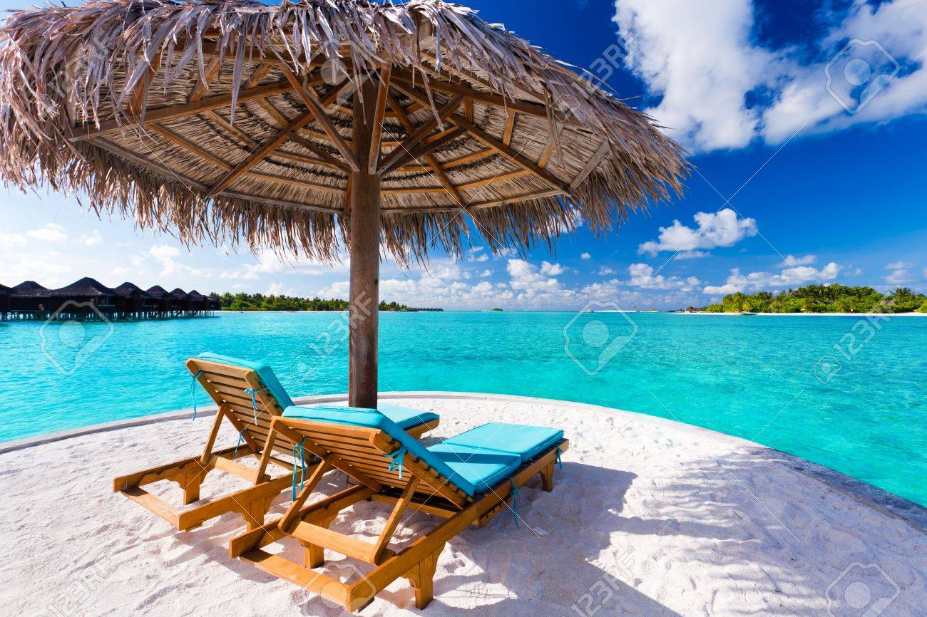 Stock Photo   Two Chairs And Umbrella On Stunning Tropical Beach