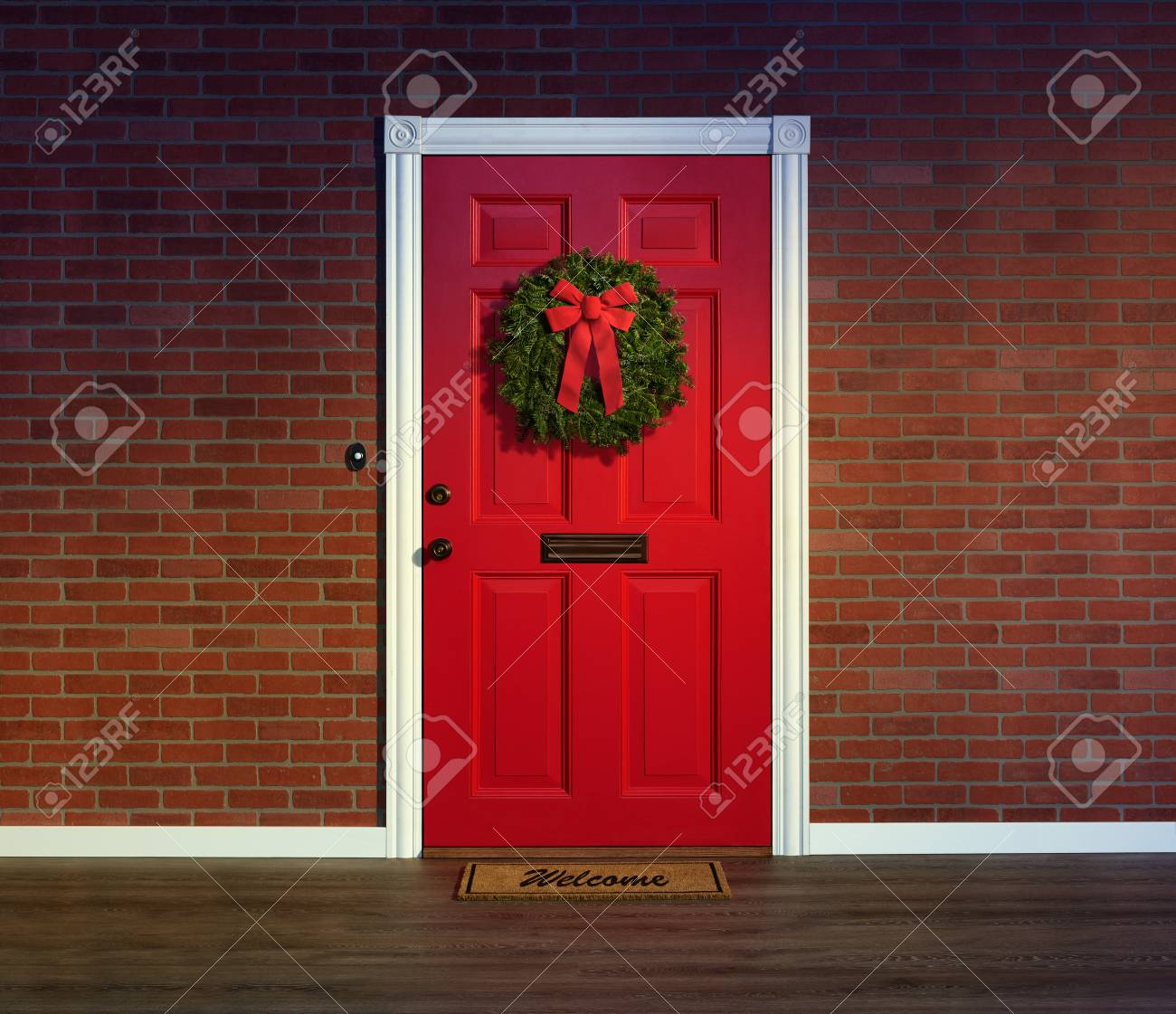 Christmas Wreath On Bright Red Front Door With Welcome Mat Stock