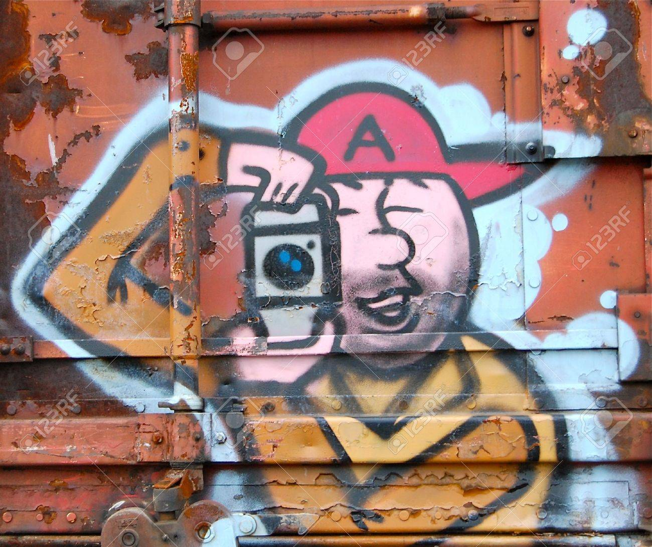 Happy Graffiti Painted On Rusted Freight Train Car Passing Through North Portland In Oregon Depicts Photographer