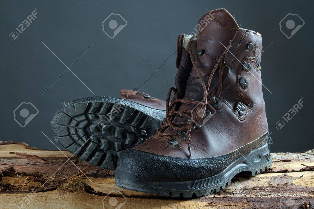 The Image Shows Used Hiking Boots On Wooden Boards Stock Photo ...