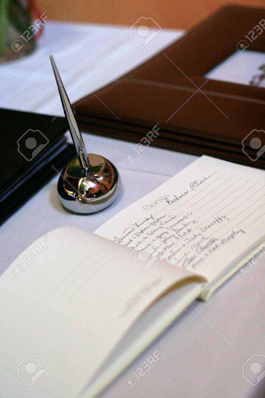 guest signing book at wedding reception Stock Photo - 263920
