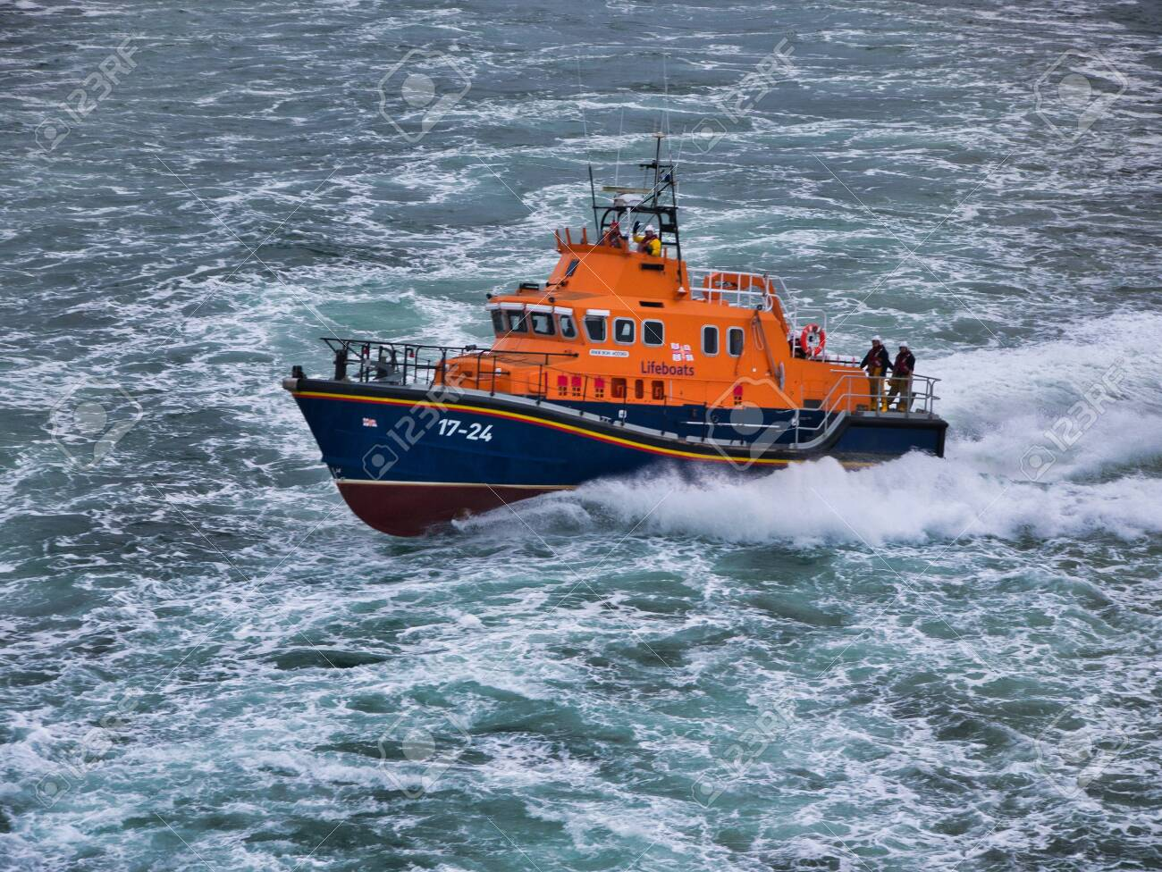 Aberdeen RNLI Lifeboat at sea, travelling at speed - this is a Severn class, self-righting, all-weather lifeboat with a crew of 7. The boat has a top speed of 25 knots and a range of 250 nautical miles. - 140052537