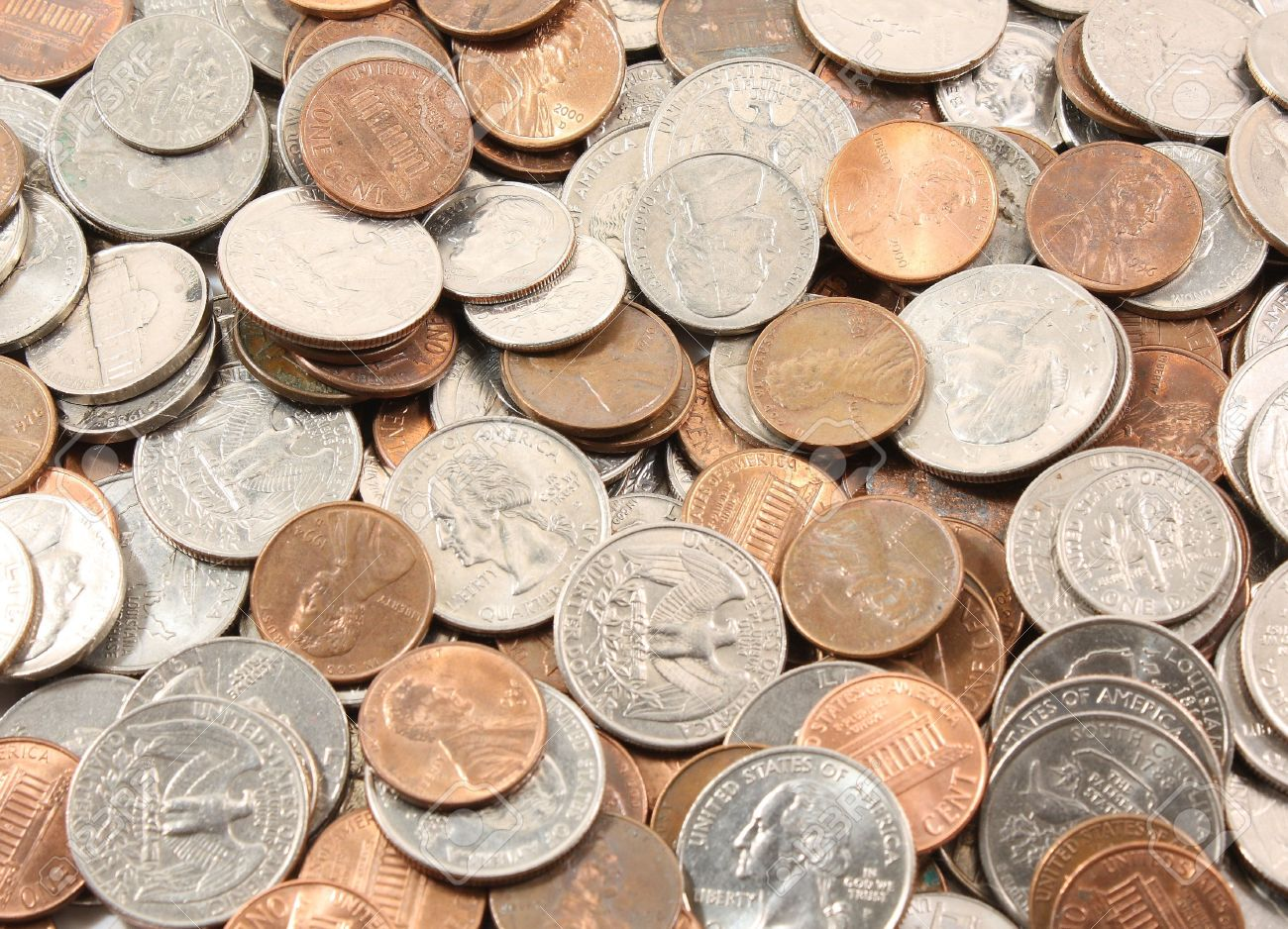 Background of US coins. Quarters, nickels, dimes, pennies.