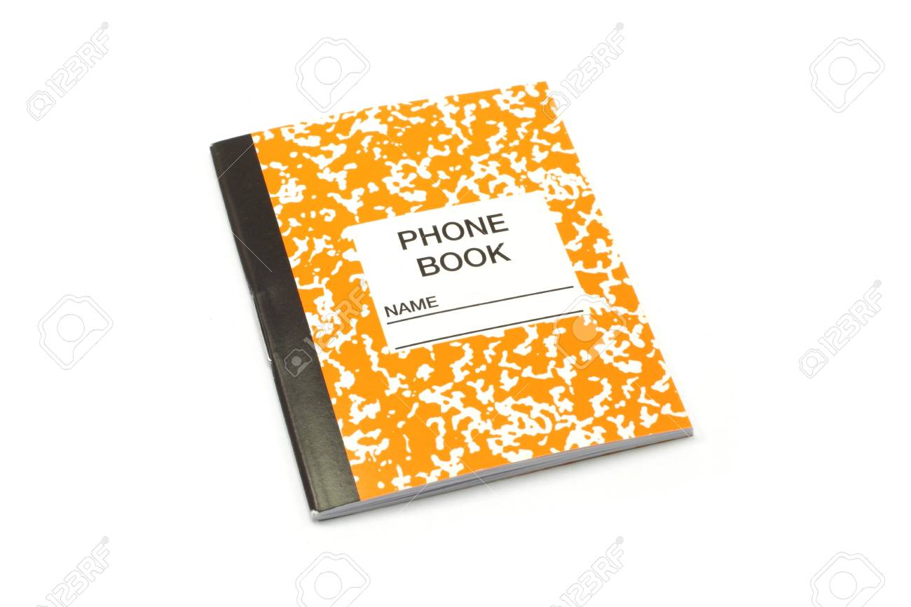 a tiny orange and white phone and address book stock photo picture