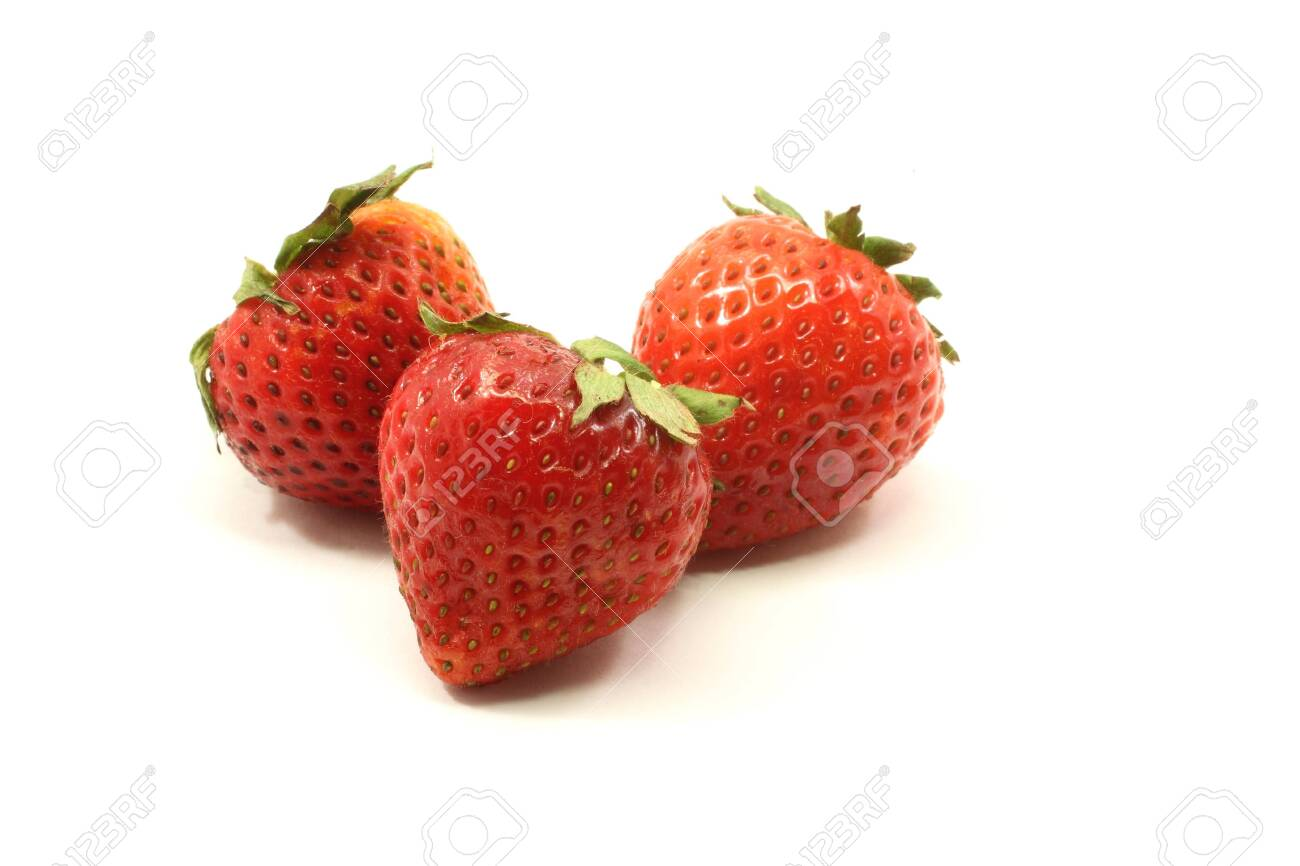 Three fresh red strawberries on a white background. Stock Photo - 6989219