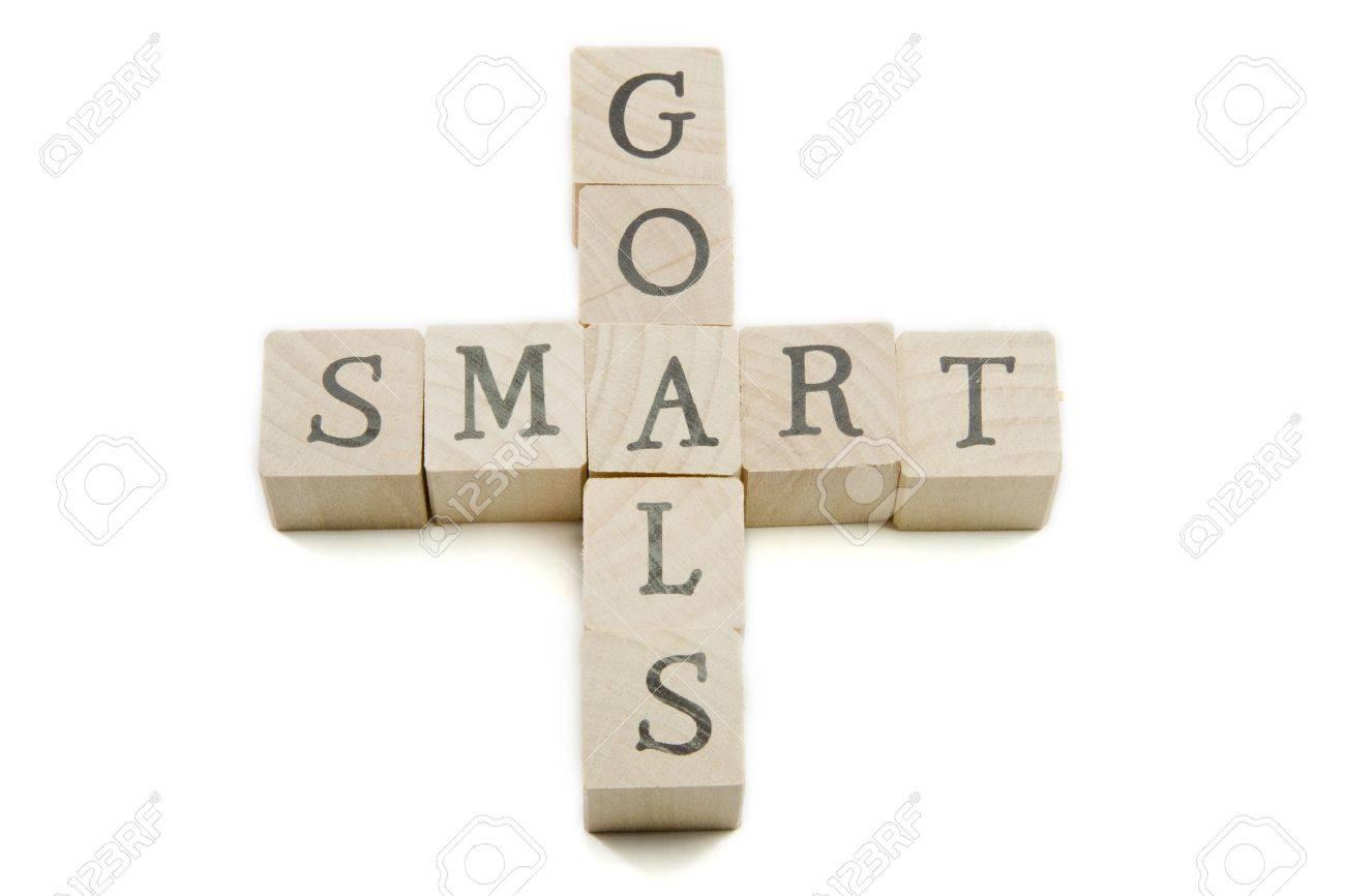 Smart Goals spelled out on wooden blocks showing smart concept. - 9356972