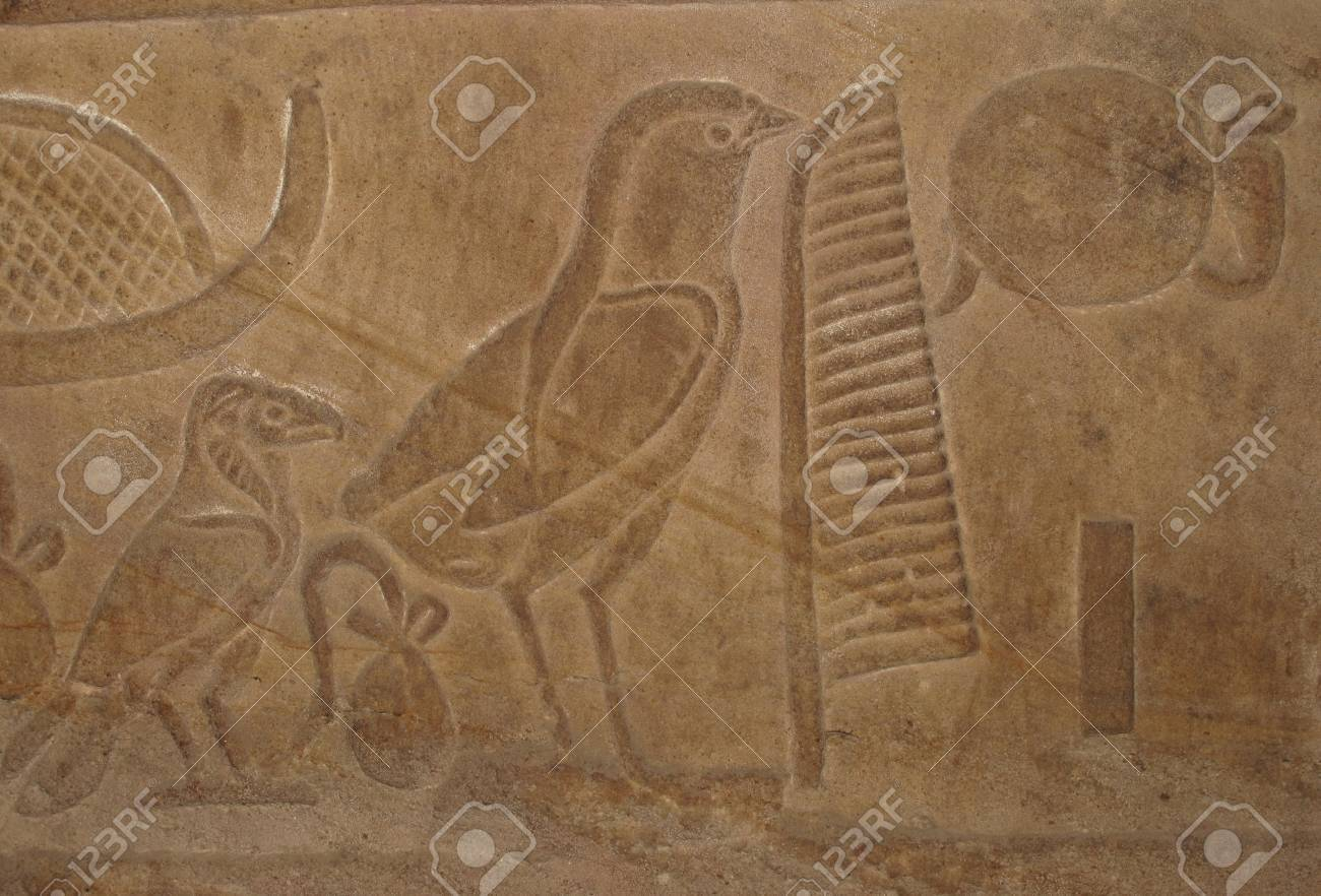 Egyptian Hieroglyphic Writing With Bird Symbols On An Ancient