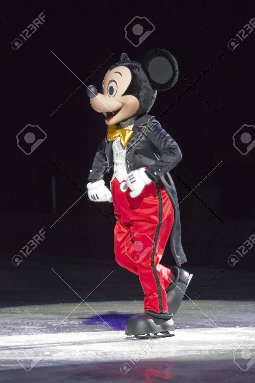 GREEN BAY, WI - MARCH 10: Mickey Mouse in red pants, black tuxedo tailsnress and skates at the Disney on Ice Treasure Trove show at the Resch Center on March 10, 2012 in Green Bay, Wisconsin. Stock Photo - 12618567