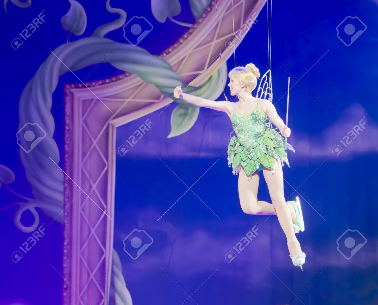 GREEN BAY, WI - MARCH 10: Tinker Bell from Peter Pan flies high above the ice the Disney on Ice Treasure Trove show at the Resch Center on March 10, 2012 in Green Bay, Wisconsin. Stock Photo - 12993736