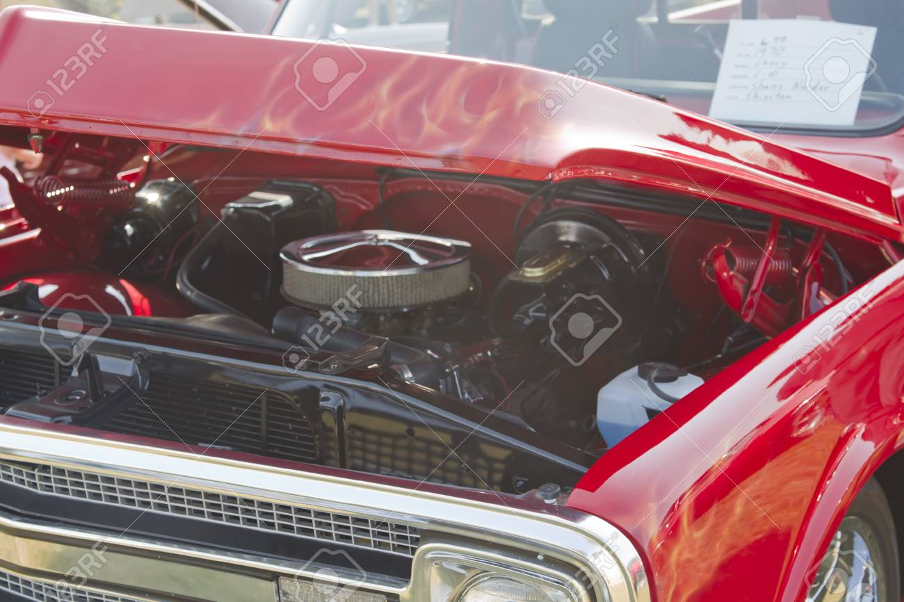 MARION, WI - SEPTEMBER 16: Hood and engine of 1970 Red Chevy Truck at the 3rd Annual Not Just Another Car Show on September 16, 2012 in Marion, Wisconsin. Stock Photo - 15723947