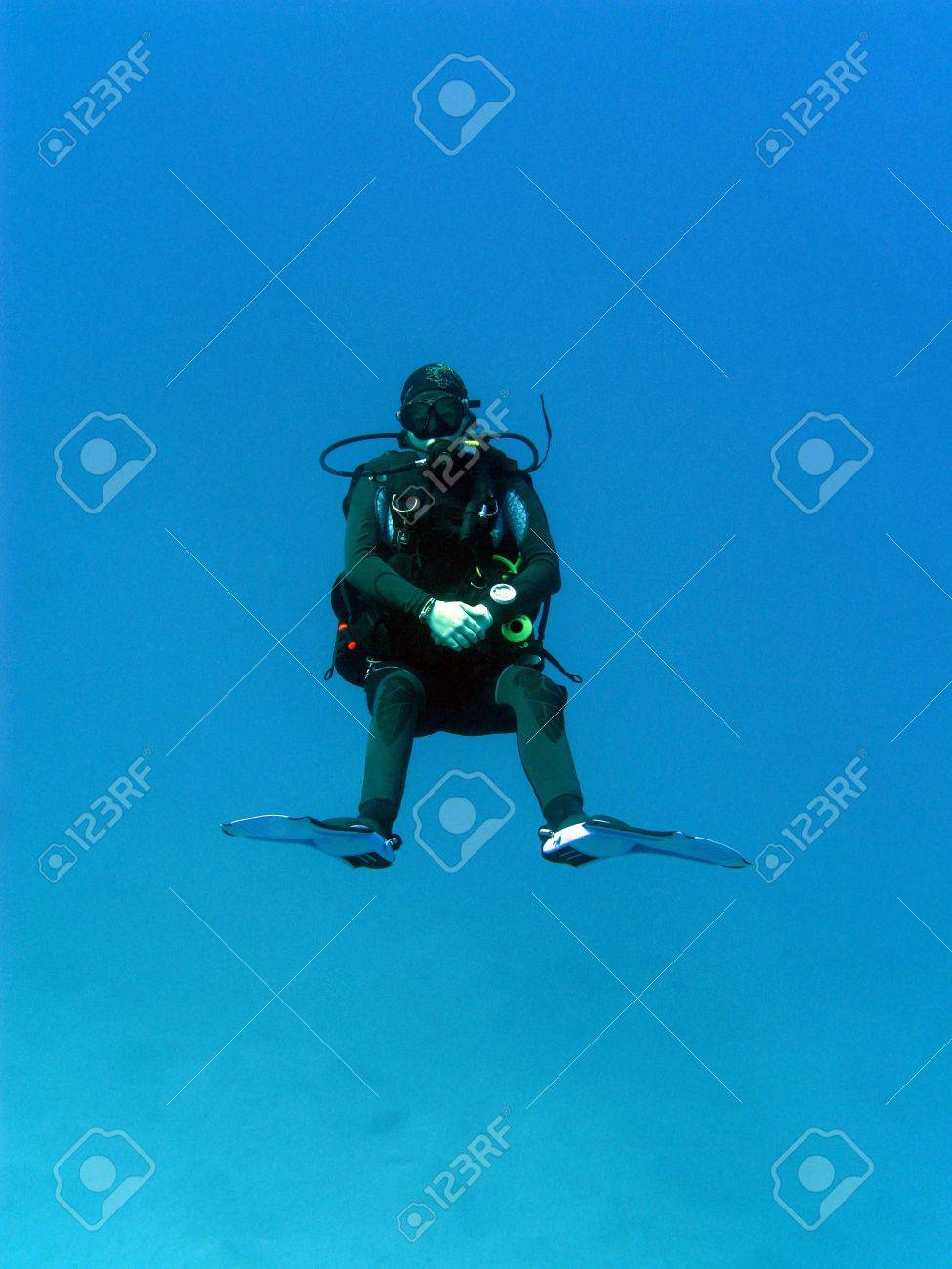girl diver under water at blue backgrund Stock Photo - 18608880