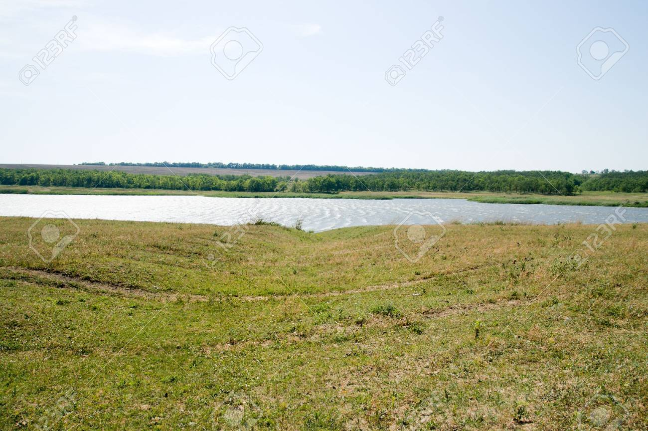 view to green meadow and little pond Stock Photo - 5538837