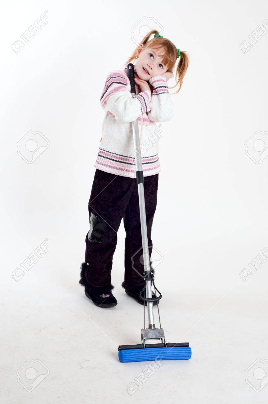 little girl with mop Stock Photo - 6465765