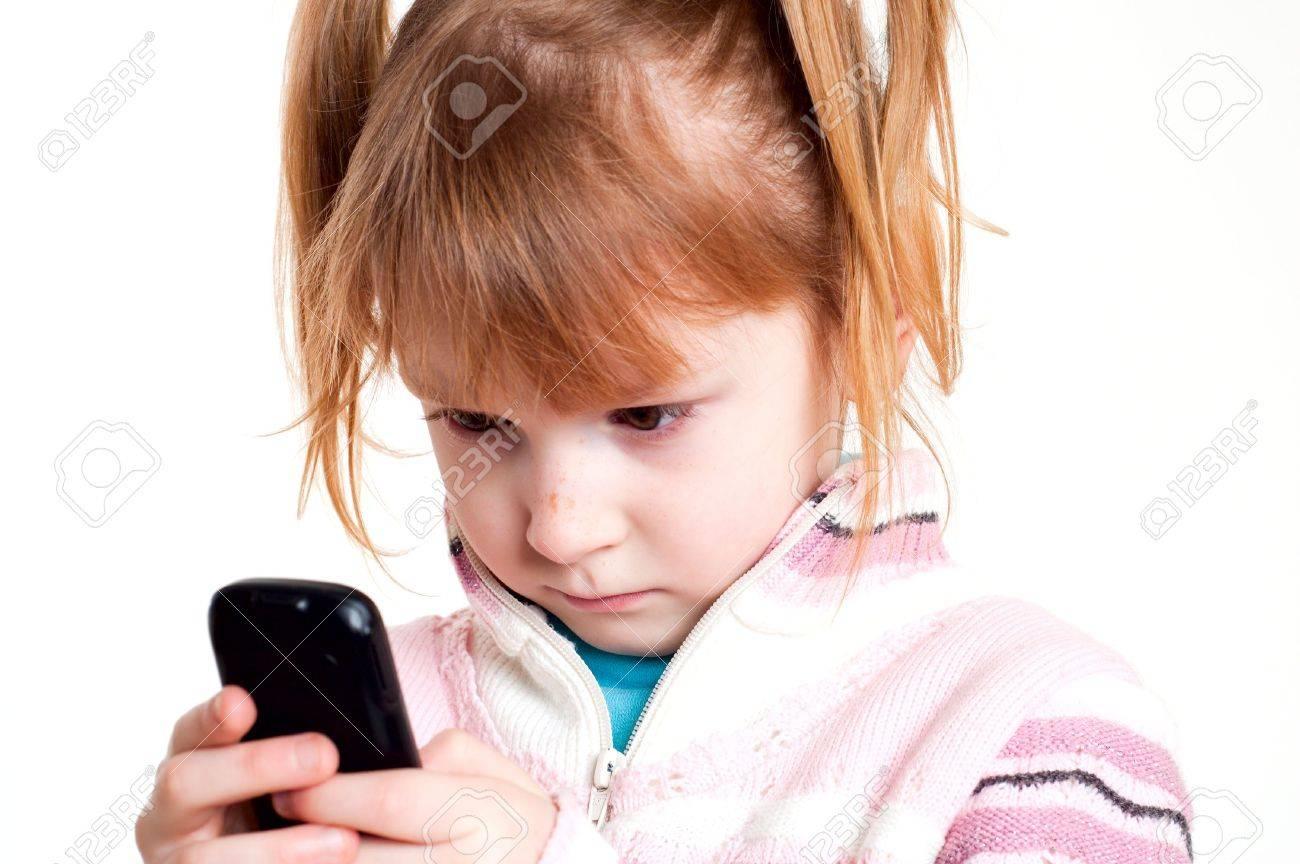 little girl looks on mobile phone Stock Photo - 6637415