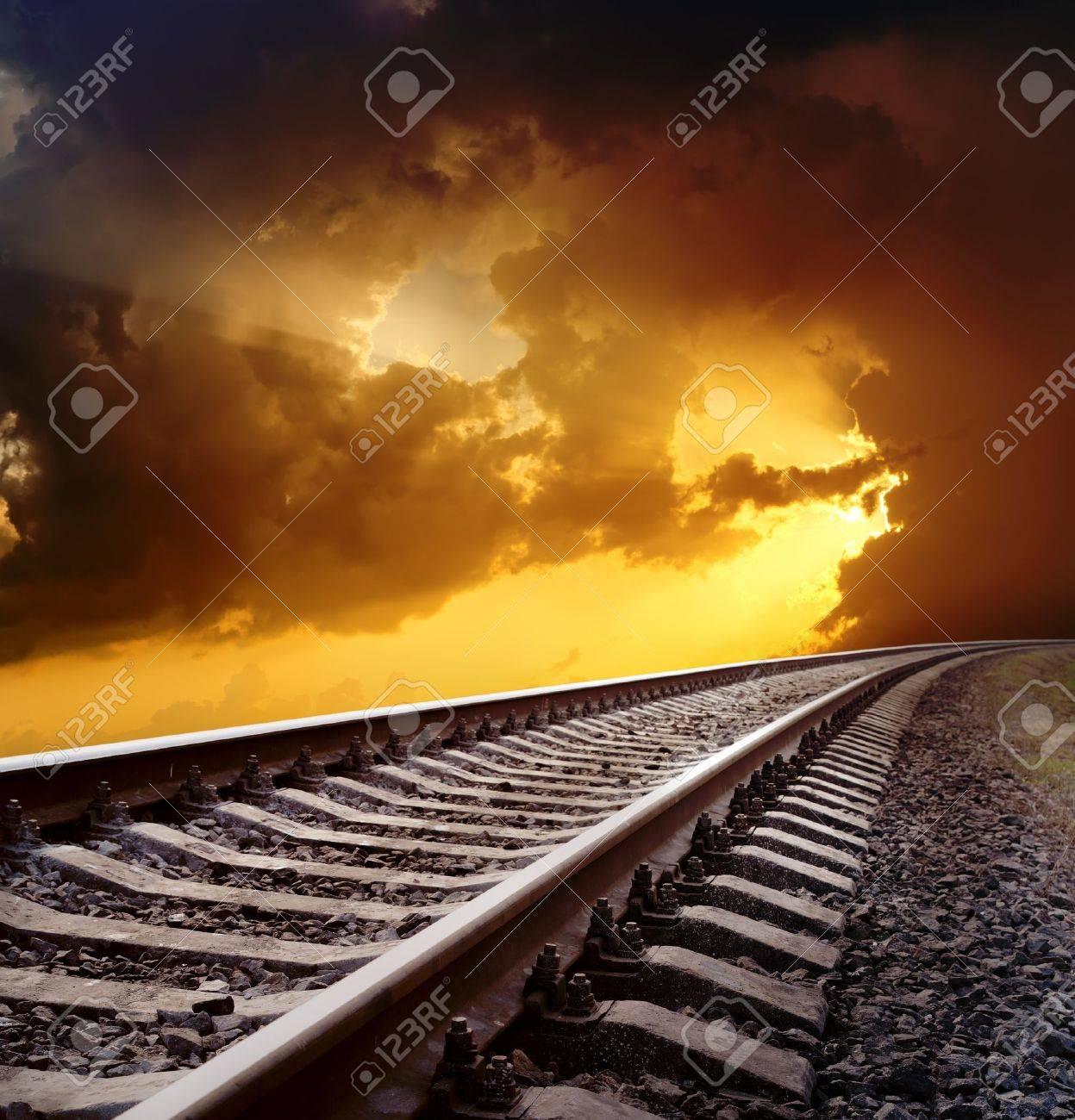 railway to horizon under dramatic sky - 10338129