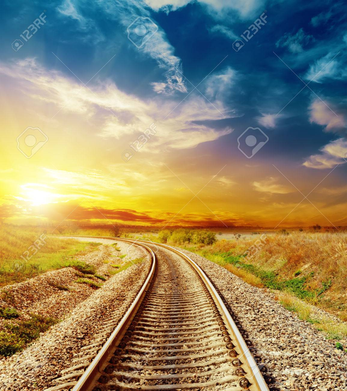 good sunset in colored sky over railroad - 31116838
